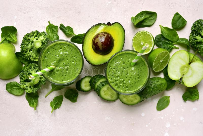 Green vegetable smoothie in a glasses.Top view with copy space royalty free stock photos