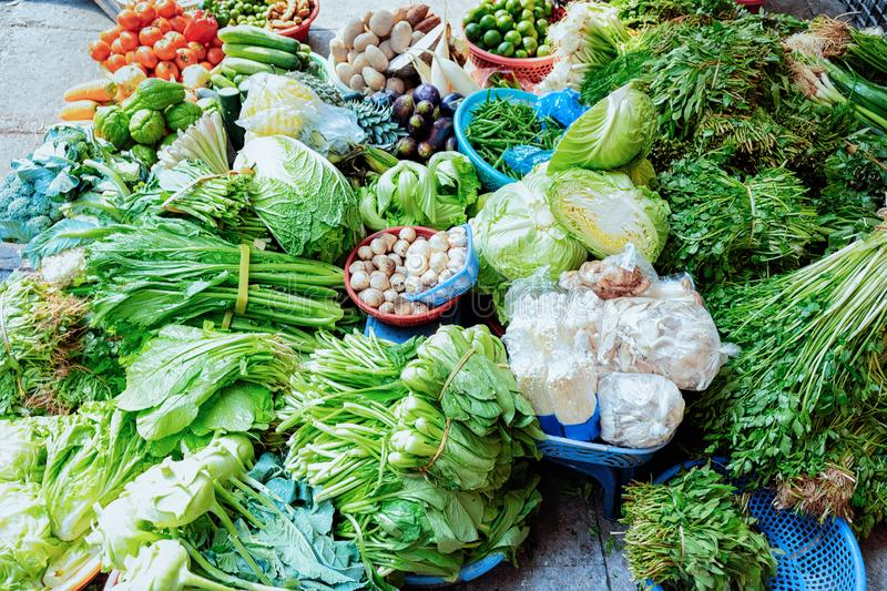 Green vegetable stuff as Exotic asian food in Hanoi. In Vietnam. Street market with Vietnamese cousine. Local produce from garden. Healthy vegetarian stuff royalty free stock photography