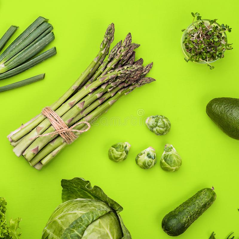 Green vegetables flat lay concept on green background royalty free stock photo