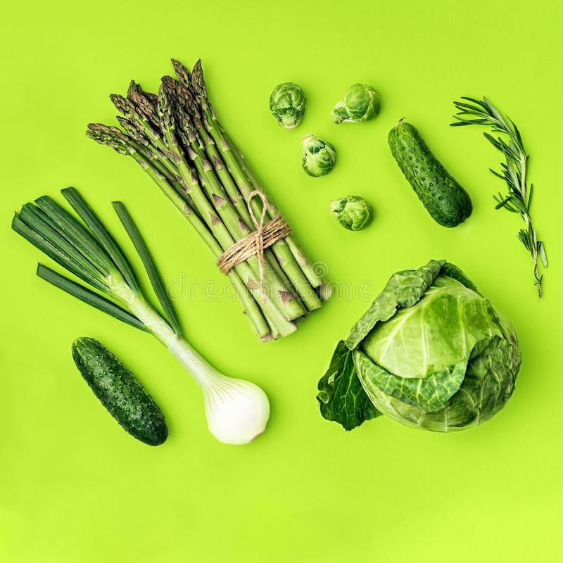 Green vegetables flat lay concept on green background stock photography