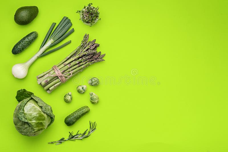 Green vegetables flat lay concept on green background royalty free stock image