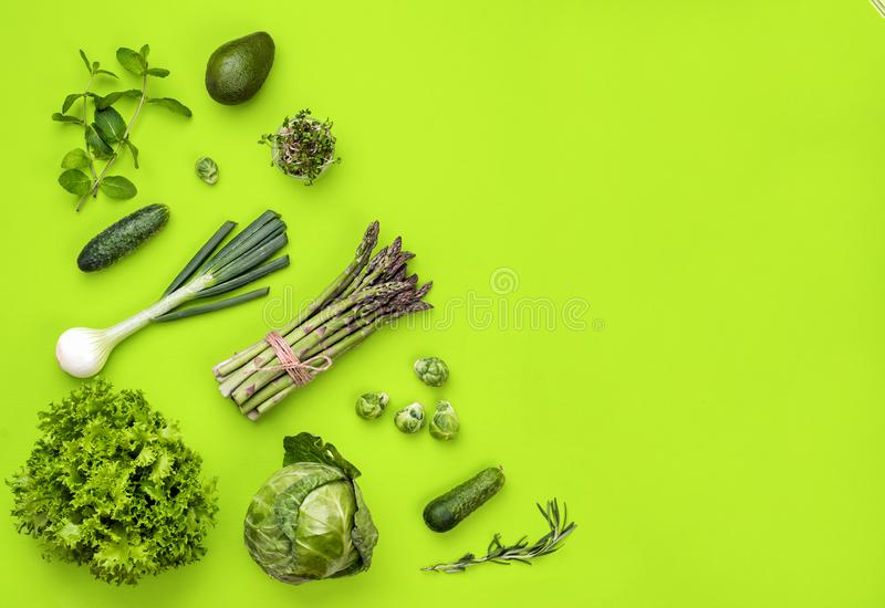 Green vegetables flat lay concept on green background stock photo