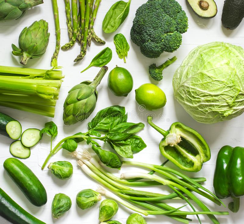 Green vegetables and fruits on a white background. Fresh organic healthy food. stock photo