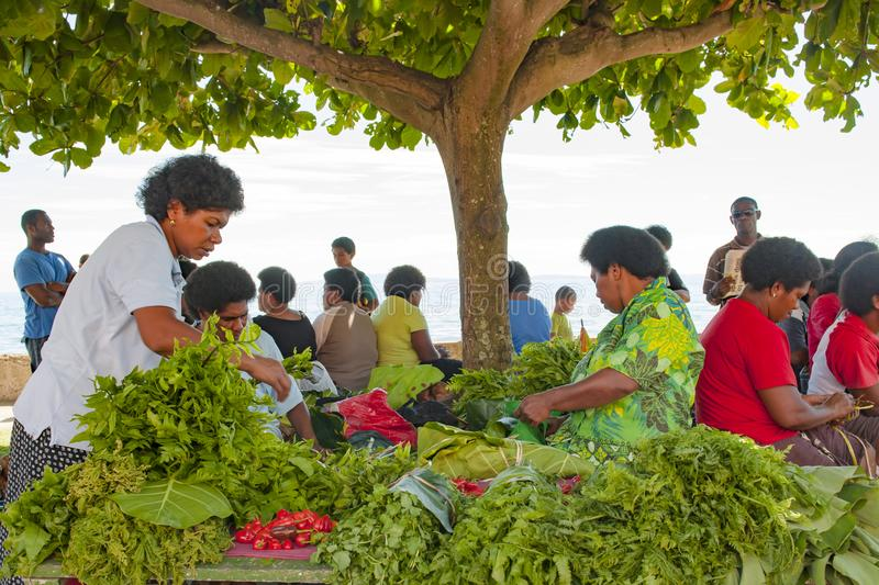 Fresh green salad and vegetables on tropical market on island in Pacific Ocean stock photography
