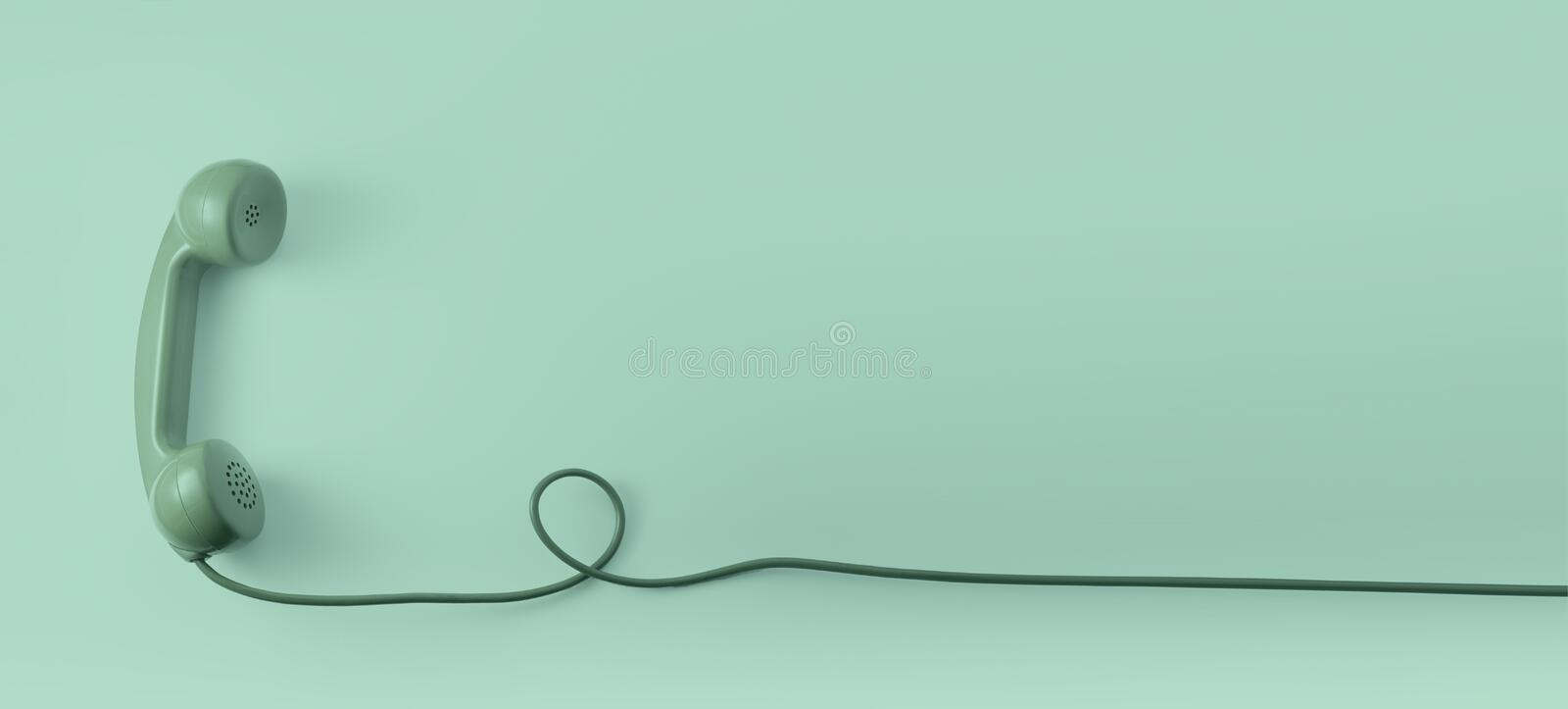 A green vintage dial telephone handset with green background. Business card stock photography