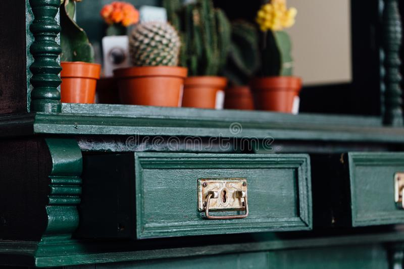Green Vintage old chest of drawers with open empty drawers. stock photography
