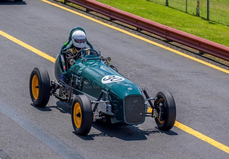 Green vintage racing car at Sandown racecourse royalty free stock photo