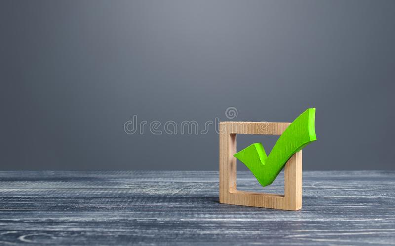 Green voting tick in a box. Checkbox. Democratic elections, referendum. The right to choose, change of power. Checklist. For verification and self-discipline royalty free stock image