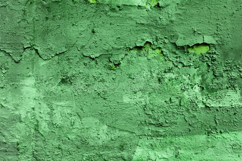 The green wall texture pattern. In the street stock photo
