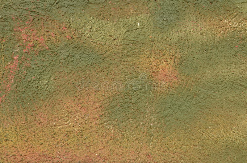 Green wall texture. Texture of the plastered wall airbrushed with green and pink graffiti paint stock photography