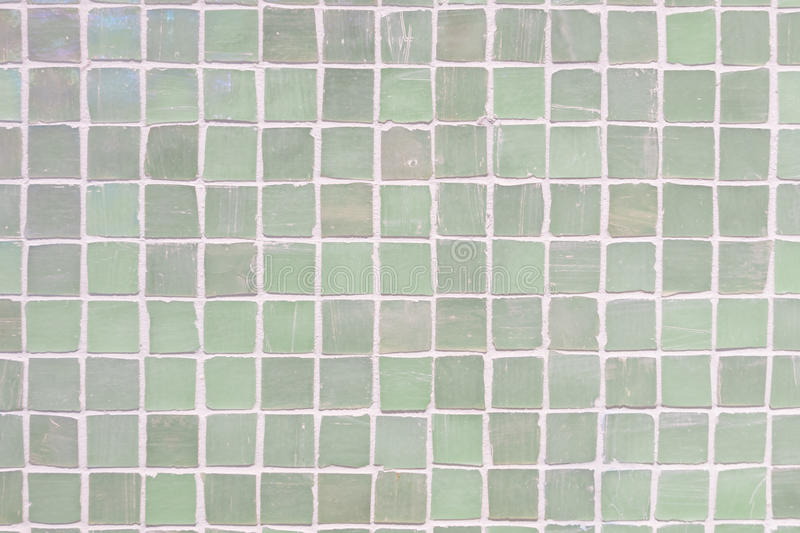 Green wall tiles porcelain mosaic texture background. beautiful cozy vintage style interior home decoration. royalty free stock photos