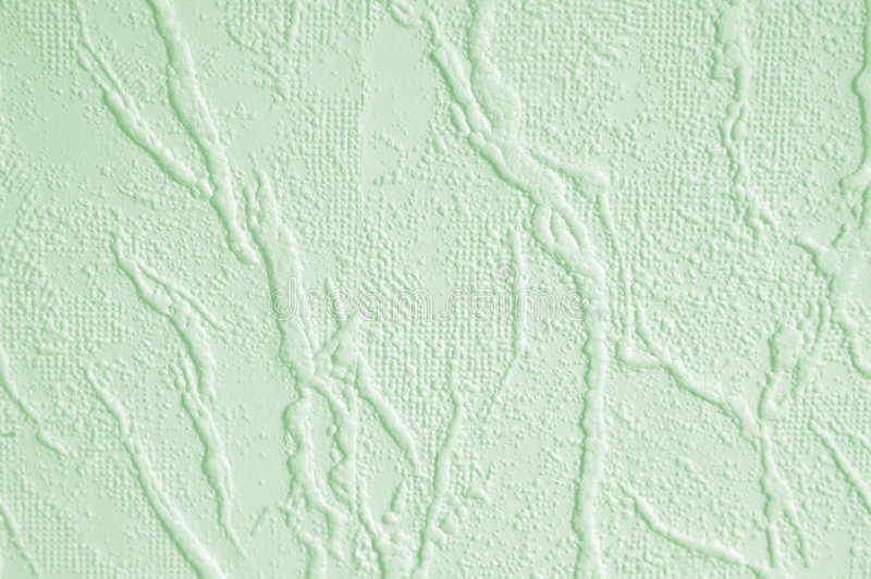 Green wallpaper. Pale green textured wallpaper in stone cracked texture stock image