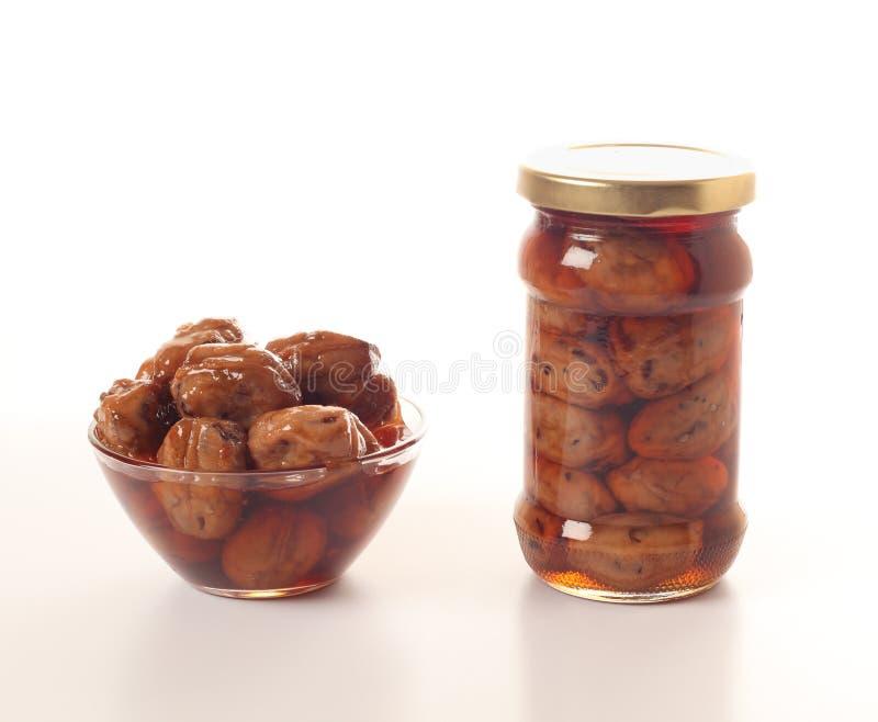 Green walnut jam royalty free stock photography