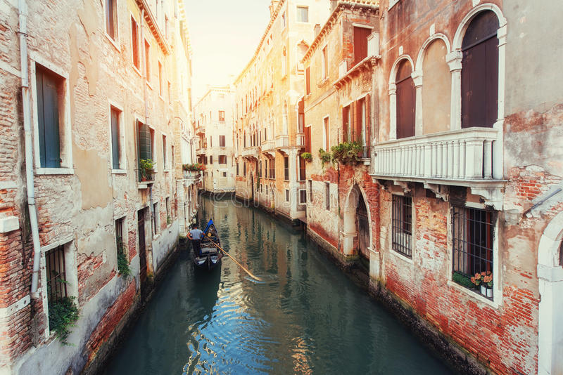 Green water canal with gondolas and colorful facades stock photo