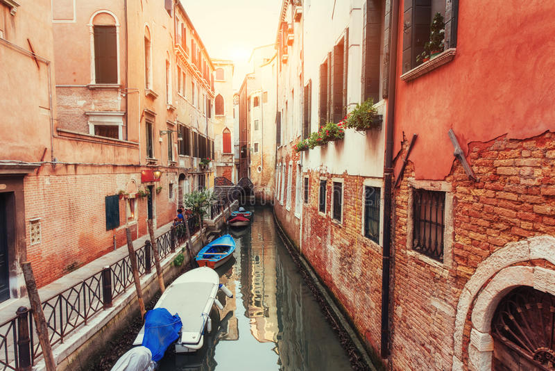 Green water canal with gondolas and colorful facades royalty free stock images
