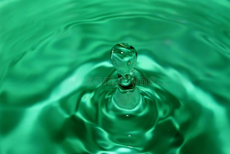 Green water drop with waves on the surface.Third stock images