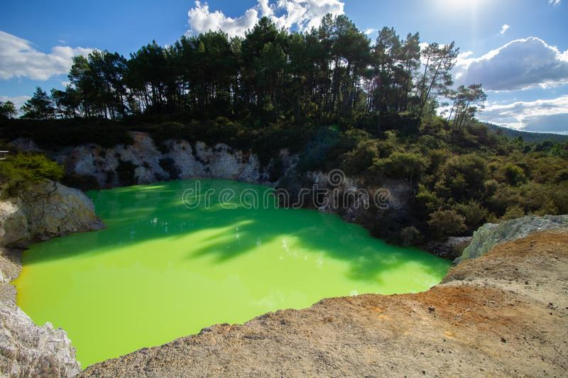 Green water pool in geothermal area very low PH water royalty free stock images