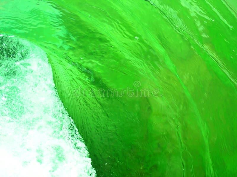 Green water swirl stock photos