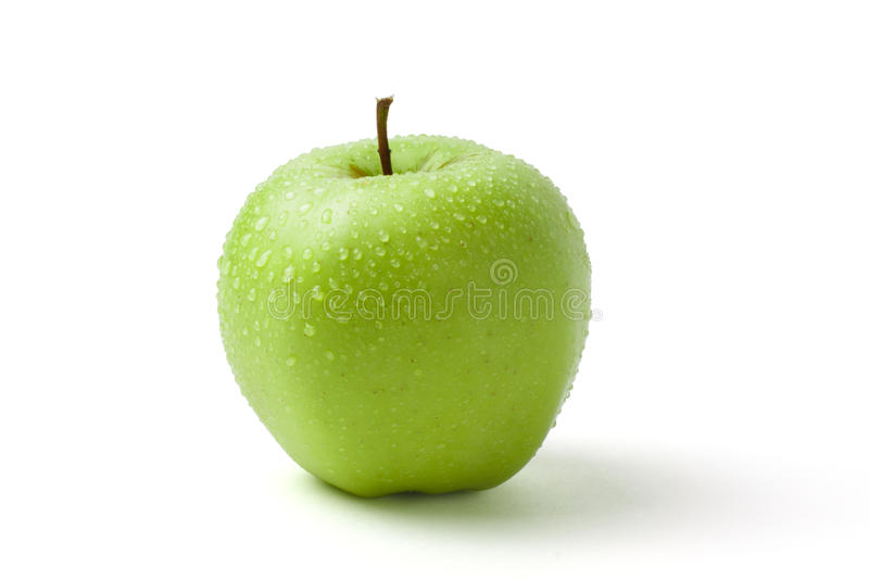 Green wet apple with water drops on white background stock photo