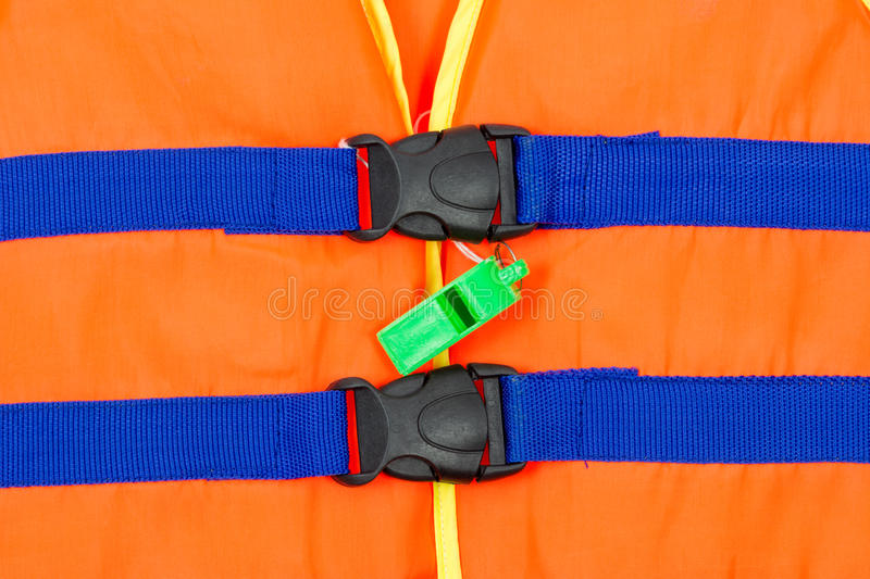 Green whistle on part of life jacket royalty free stock images