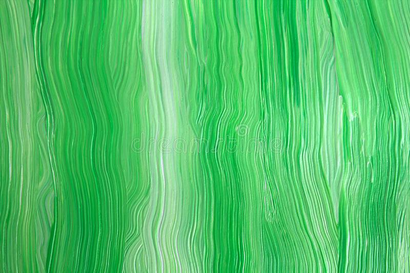 Green and white. Abstract background.acrylic paint.Close-up. Spilled acrylic paint. Freshly painted wall stock photography