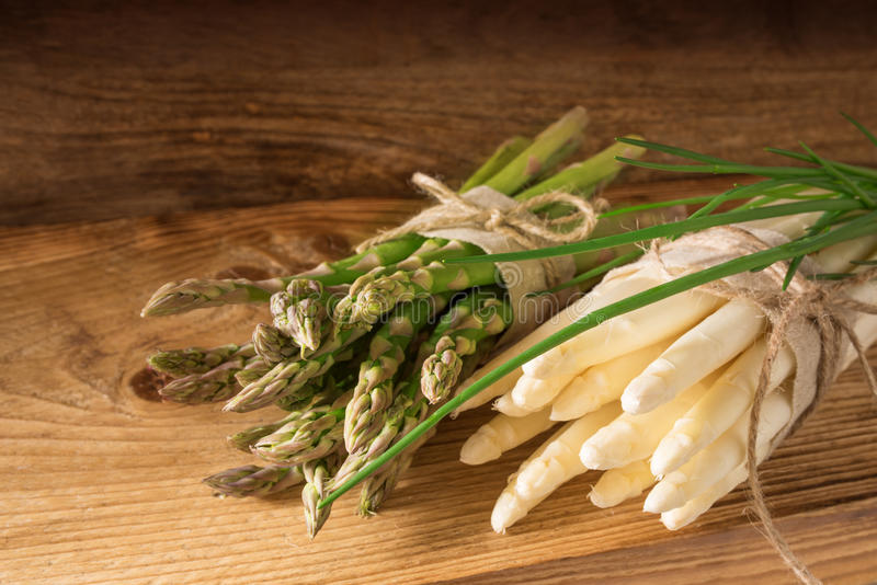 Green and white asparagus on wood stock photos