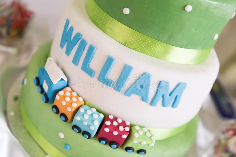 Green and White Birthday Cake with Train Decoration stock photo