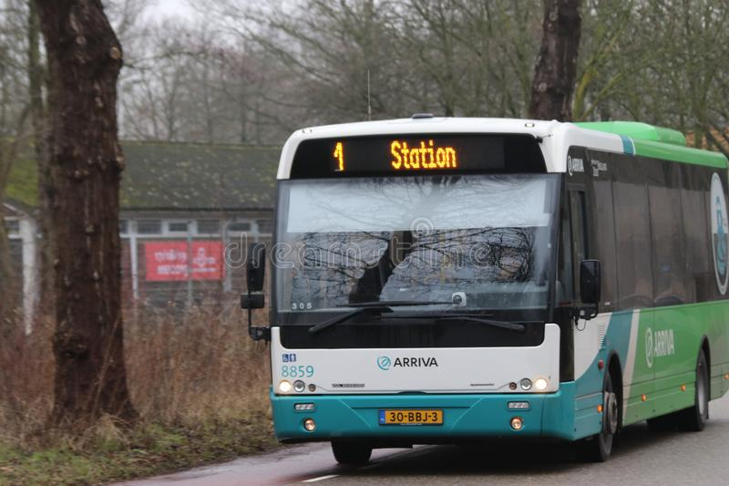 Green and white bus of arriva for city line 1 in the town of Gouda. stock images