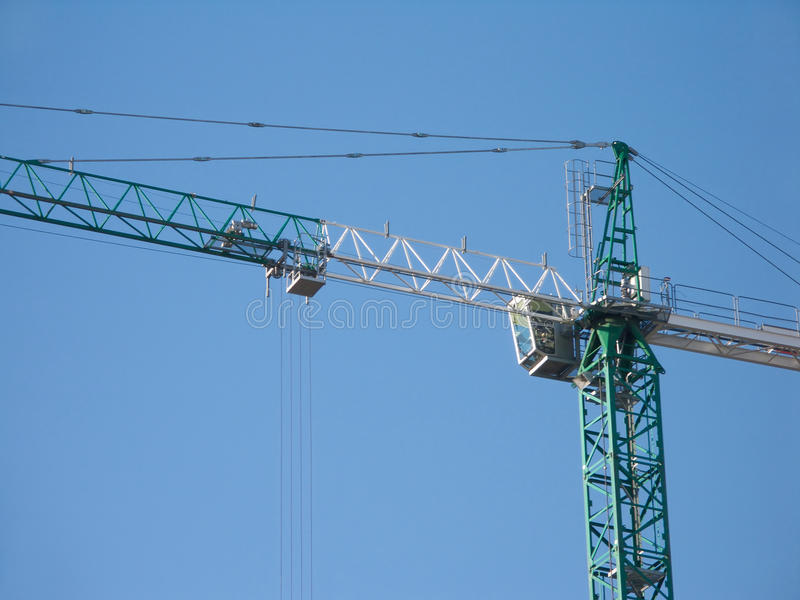 Download Green And White Construction Hoisting Crane Over C Stock Photo - Image of cabin, building: 21899986