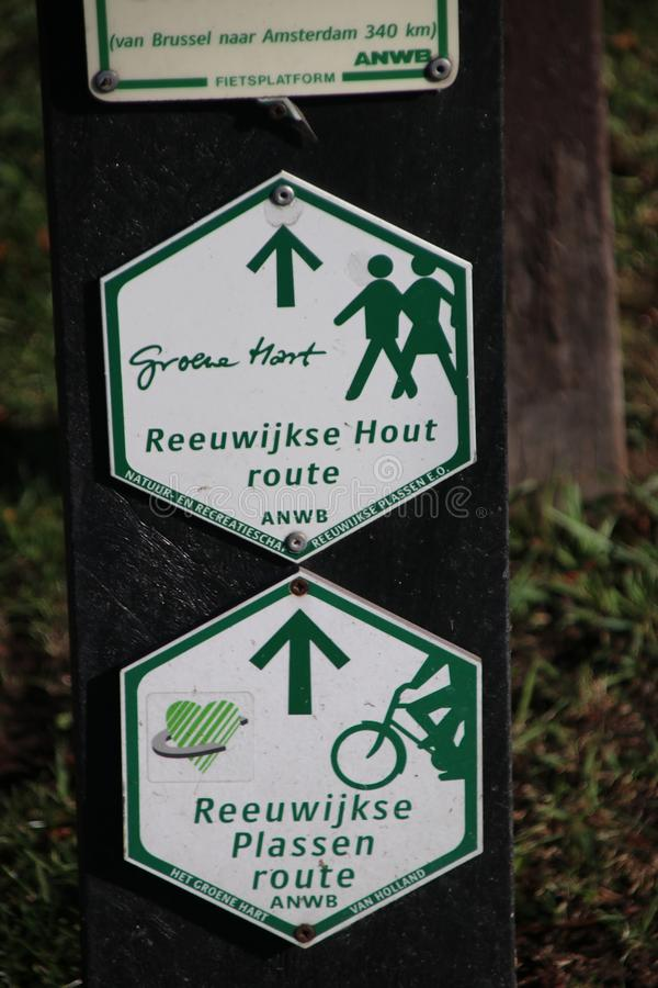 Green and white direction signs for hiking and pedistrians in the Groene Hart at the Reeuwijkse hout. royalty free stock photography