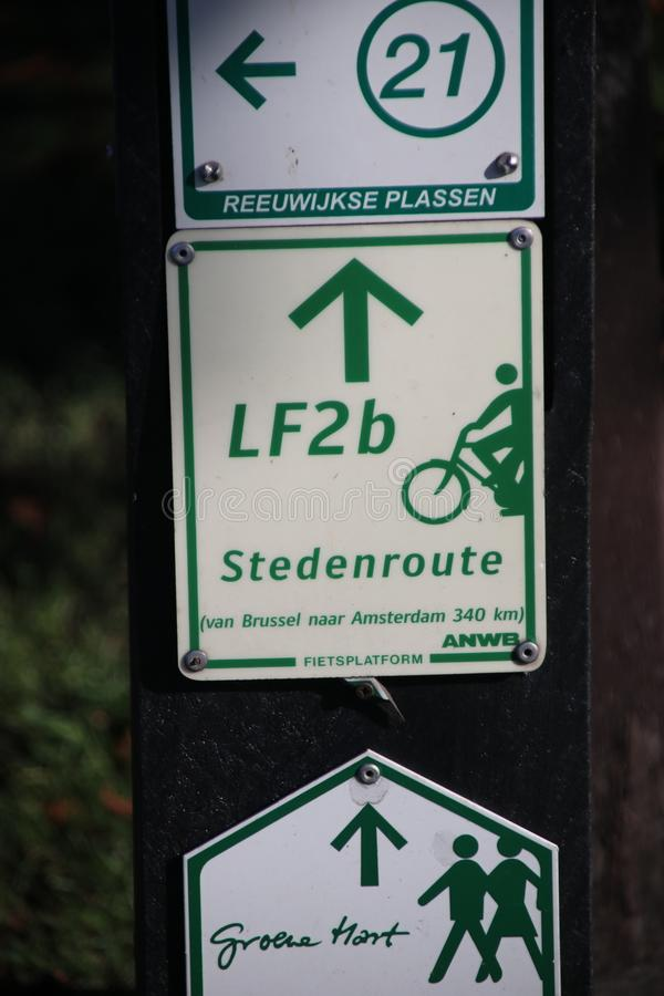Green and white direction signs to the nearest node in the network for cyclist in the Netherlands. royalty free stock images