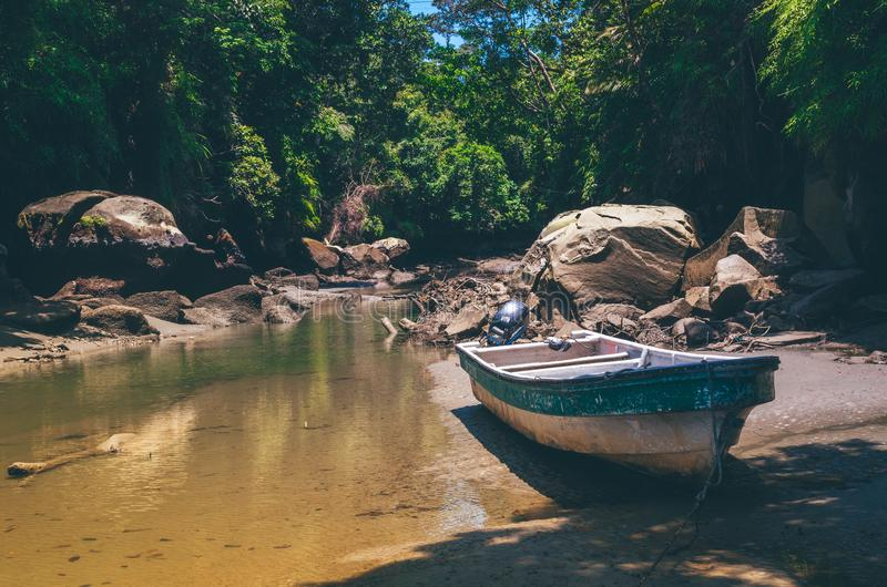 Green and White Fishing Boat Near Body of Water stock photography