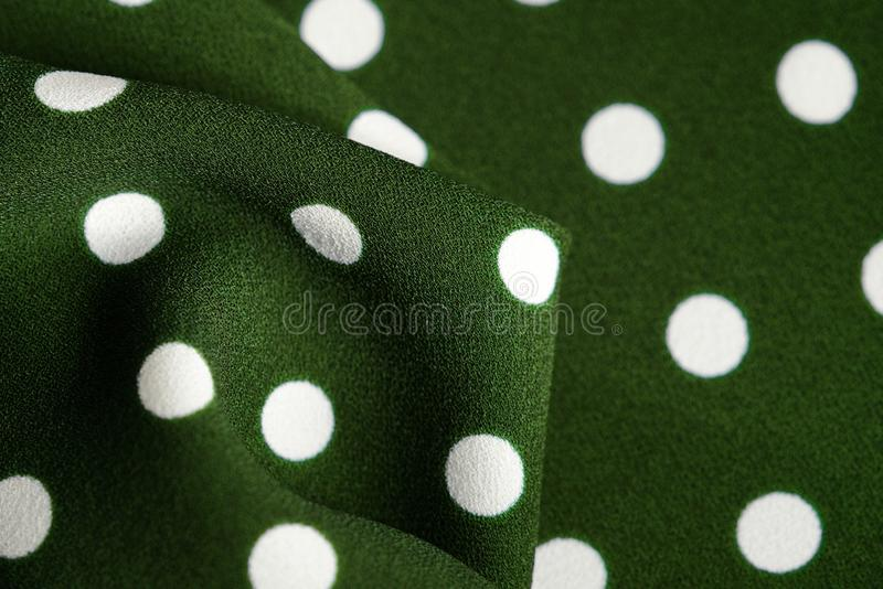Green and white polka dot textile. Abstract background. Green and white polka dot textile close up. Abstract background royalty free illustration