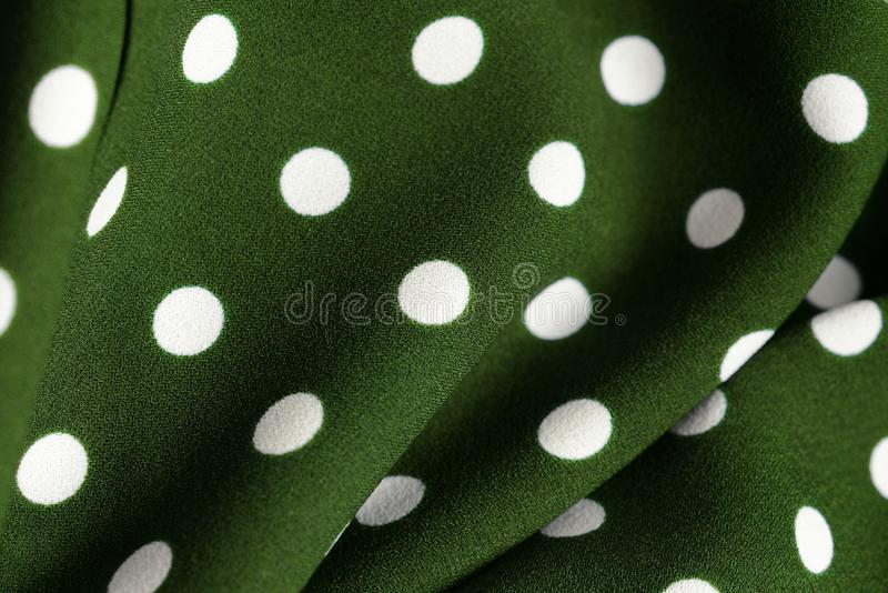 Green and white polka dot textile. Abstract background. Green and white polka dot textile close up. Abstract background vector illustration