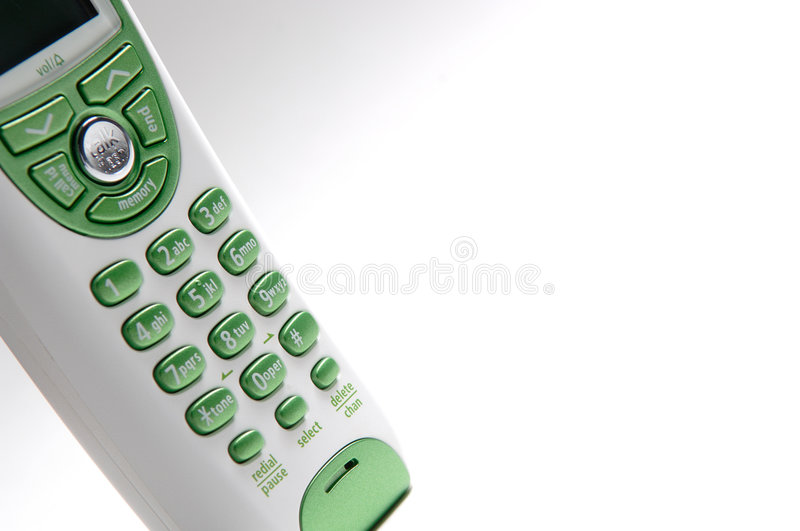 Green and White Telphone. Green and white handheld telephone royalty free stock image