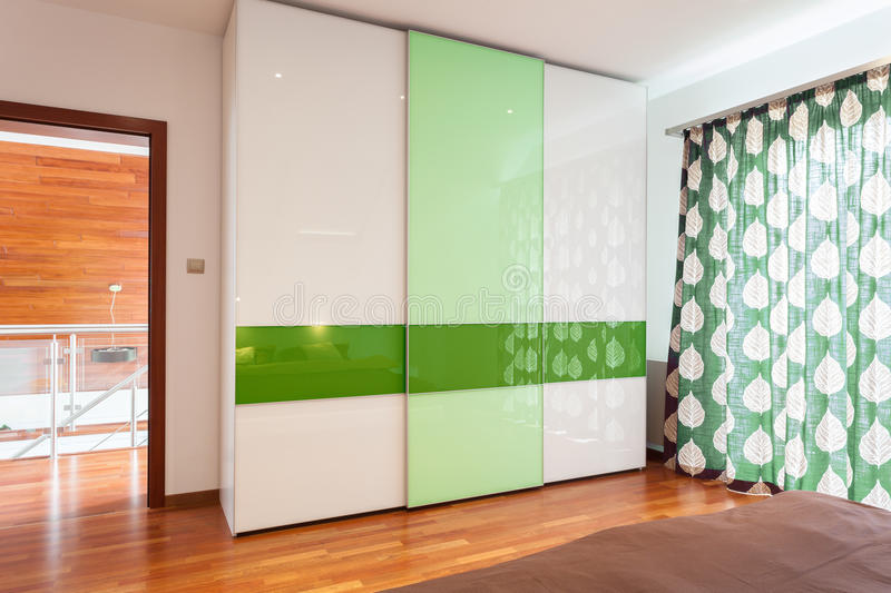 Green and white wardrobe. In new house royalty free stock photos
