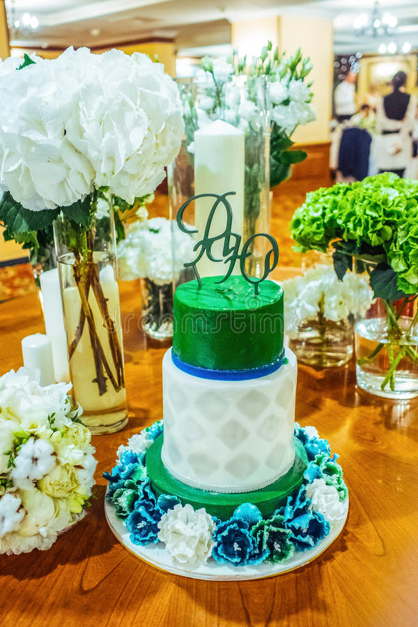 Green and white wedding cake royalty free stock image