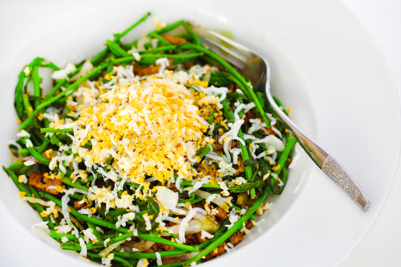 Green wild pencil asparagus with grated egg, salad royalty free stock photos