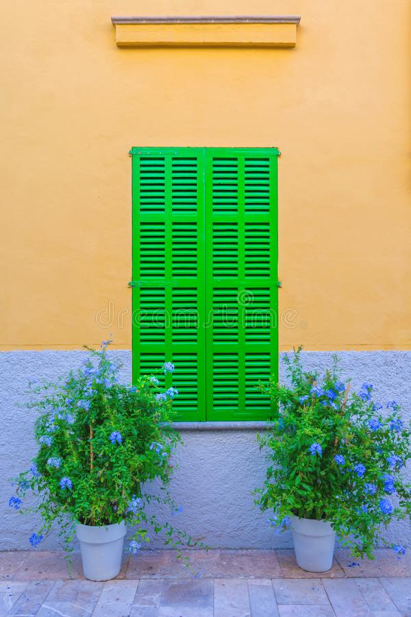Green window on old traditional house in Mallorca, Spain royalty free stock image