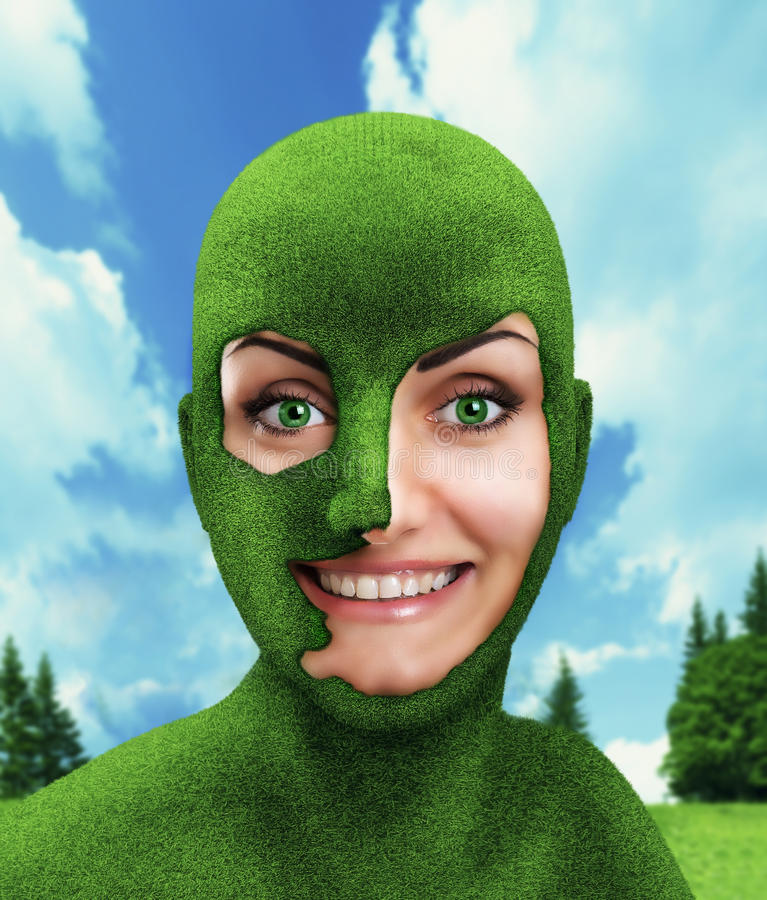 Green woman's head on nature stock photography