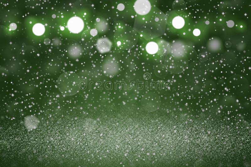 Green wonderful shining glitter lights defocused bokeh abstract background with sparks fly, holiday mockup texture with blank. Green wonderful glossy abstract royalty free stock images