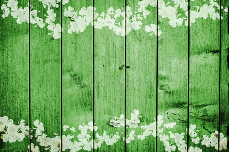 Green wooden background Print of Clovers.  royalty free stock image