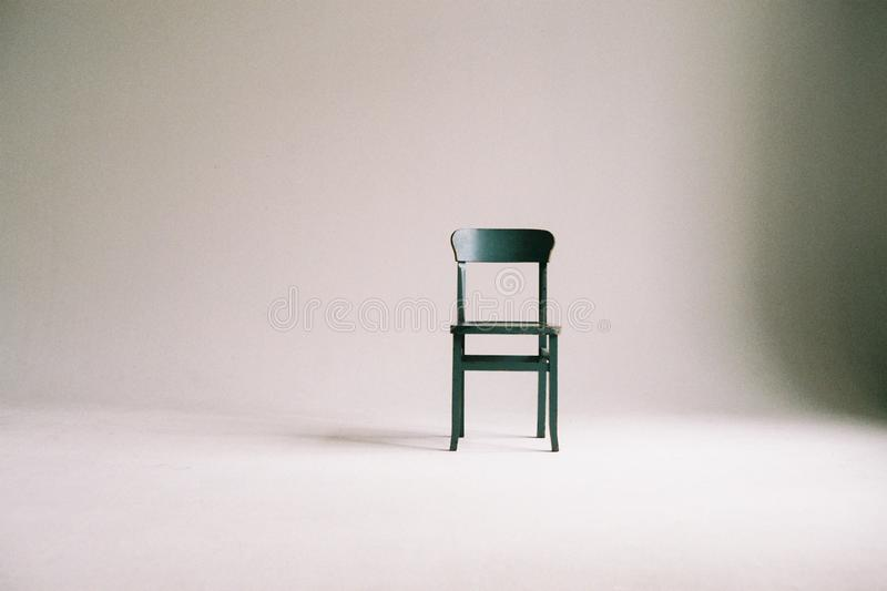 Green Wooden Chair on White Surface stock images