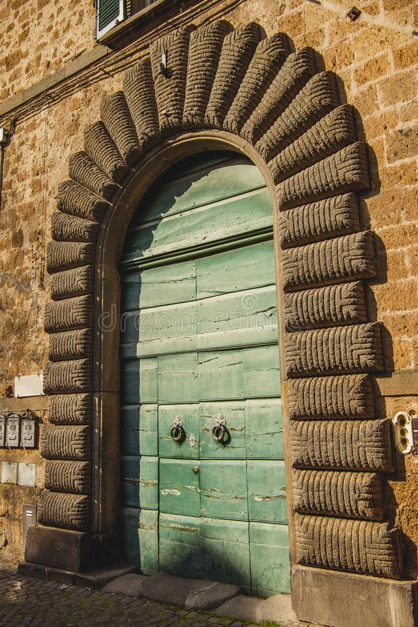 green wooden doors in Orvieto, Rome royalty free stock photo