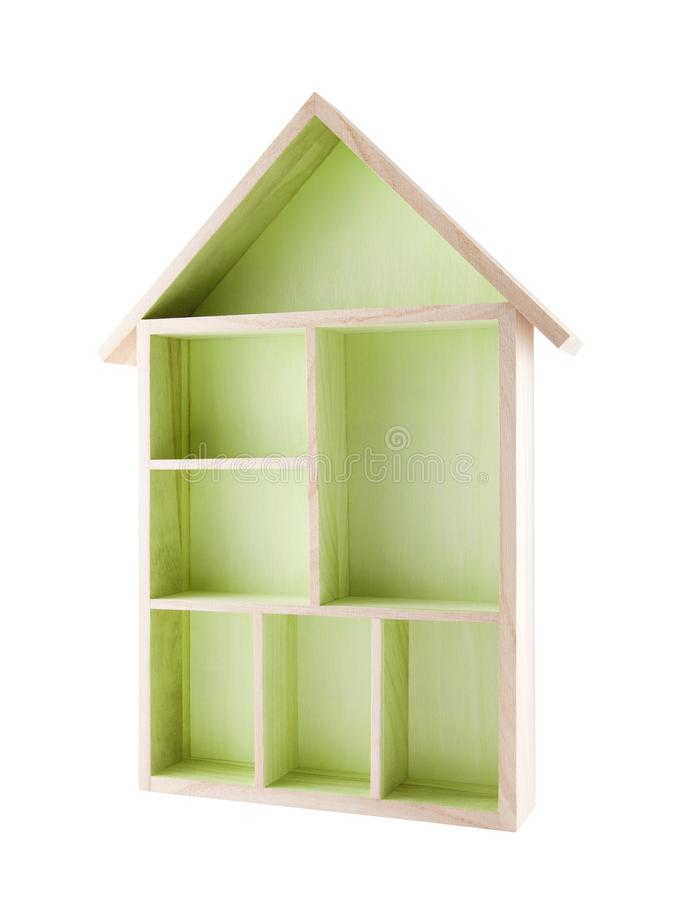 Green wooden house shaped shelf stock photography