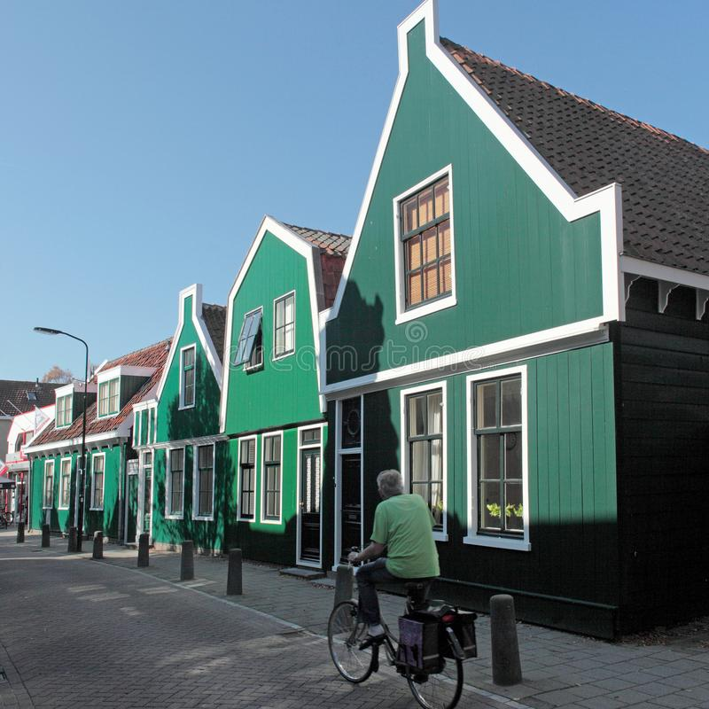 Wooden houses in Krommenie in the Netherlands. Green wooden houses in Krommenie in Noord-Holland in the Netherlands royalty free stock photos