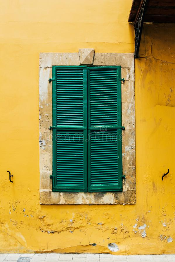 Green wooden window on the old yellow building. Wooden window. Old window. Window shutters royalty free stock photos