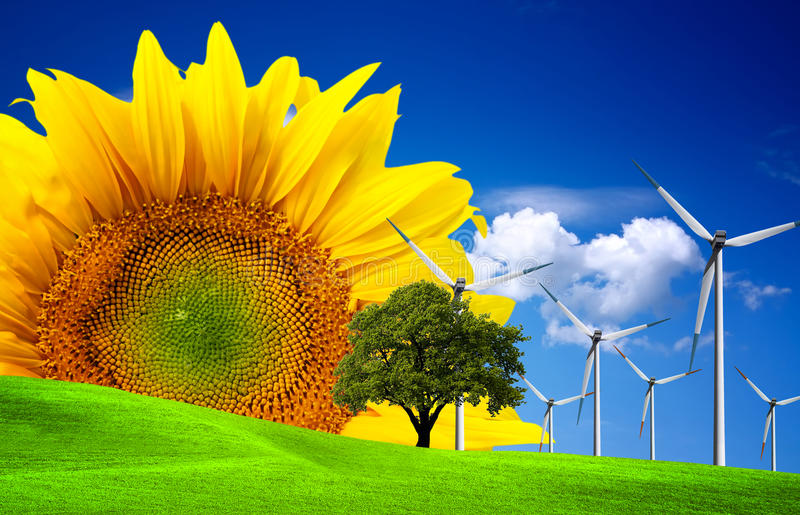 Green world ecology concept. Windmill on green field royalty free stock image