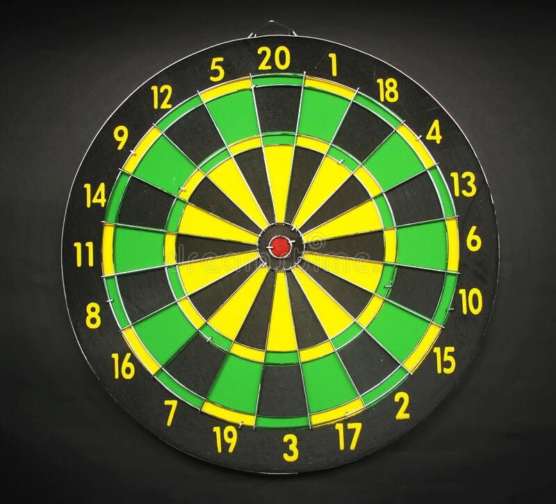 Green Yellow and Black Round Dart Board With Black Background royalty free stock photo