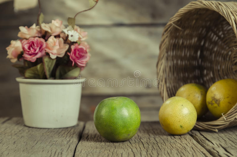 Green and yellow colour of the orange with basket royalty free stock images